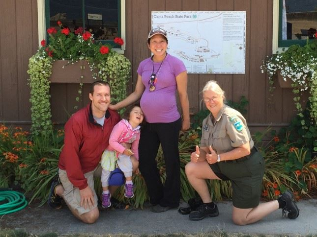 Ranger Tina Dinzl-Pedersen (far right) with the latest family to complete the State Parks Geotour Ch